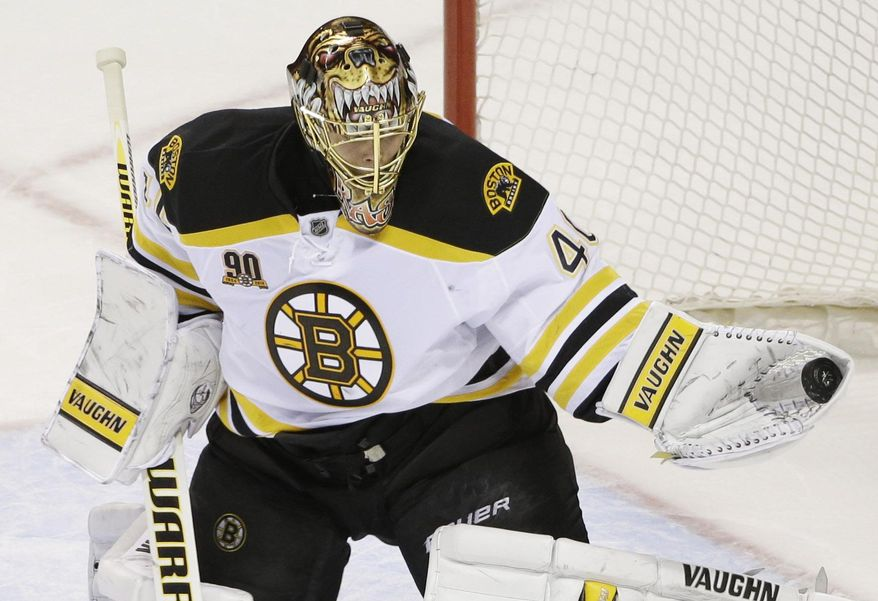 Boston Bruins goalie Tuukka Rask (40), of Finland, make a save against the San Jose Sharks during the first period of an NHL hockey game on Saturday, Jan. 11, 2014, in San Jose, Calif. (AP Photo/Marcio Jose Sanchez)