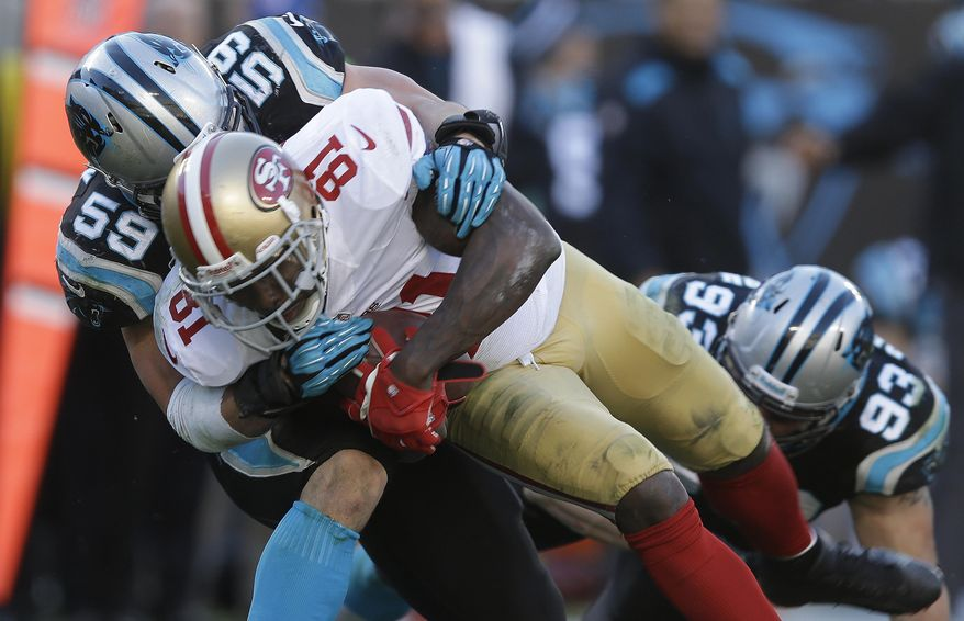 San Francisco 49ers wide receiver Anquan Boldin (81) makes a catch against Carolina Panthers middle linebacker Luke Kuechly (59) during the second half of a divisional playoff NFL football game, Sunday, Jan. 12, 2014, in Charlotte, N.C. (AP Photo/Gerry Broome)
