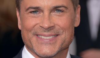 Rob Lowe arrives at the 71st annual Golden Globe Awards at the Beverly Hilton Hotel on Sunday, Jan. 12, 2014, in Beverly Hills, Calif. (Photo by John Shearer/Invision/AP) ** FILE **
