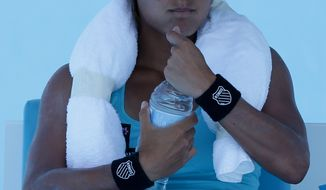 Heather Watson of Britain takes a drink during a break in her first round match against Daniela Hantuchova of Slovakia at the Australian Open tennis championship in Melbourne, Australia, Monday, Jan. 13, 2014. (AP Photo/Aaron Favila)