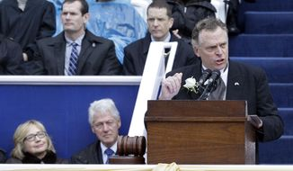 Virginia Gov. Terry McAuliffe, right, delivers his inaugural address as former U.S. Secretary of State Hillary Rodham Clinton, left, and former U.S. President Bill Clinton look on during inaugural ceremonies at the Capitol in Richmond, Va., Saturday, Jan. 11, 2014. McAuliffe is the 72nd governor of Virginia. (AP Photo/Patrick Semansky) ** FILE **