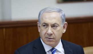 Israeli Prime Minister Benjamin Netanyahu, attends the weekly cabinet meeting in Jerusalem, Sunday, Jan. 12, 2014. Sharon, the hard-charging Israeli general and prime minister who was admired and hated for his battlefield exploits and ambitions to reshape the Middle East, died Saturday, eight years after a stroke left him in a coma from which he never awoke. He was 85. (AP Photo/Olivier Fitoussi, Pool)
