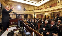 Gov. Terry McAuliffe delivers his first speech before the General Assembly at the state Capitol in Richmond, Va., Monday, Jan. 13, 2014. (AP Photo/Richmond Times-Dispatch, Bob Brown)
