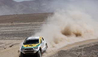 Guilherme Spinelli and co-pilot Youssef Haddad, both of Brazil, drive their Mitsubishi during the eight stage of the Dakar Rally between the cities of Salta, Argentina, and Calama, Chile, Monday, Jan. 13, 2014. (AP Photo/Victor R. Caivano)