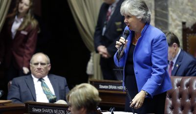 Senate minority leader Sharon Nelson, D-Maury Island, right, speaks from the floor on the first day of the 2014 session of the Washington state Legislature, Monday, Jan. 13, 2014, at the Capitol in Olympia, Wash. (AP Photo/Ted S. Warren)