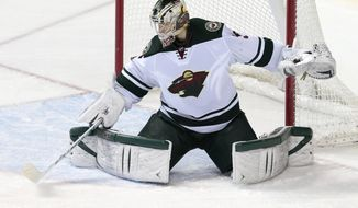 Minnesota Wild goalie Darcy Kuemper blocks a shot against the Nashville Predators in the third period of an NHL hockey game, Sunday, Jan. 12, 2014, in Nashville, Tenn. Kuemper stopped 23 shots as the Wild won 4-0. (AP Photo/Mark Humphrey)