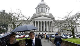A sidewalk outside the Legislative building is bustling with people on the first day of the 2014 session of the Washington state Legislature, Monday, Jan. 13, 2014, at the Capitol in Olympia, Wash. (AP Photo/Ted S. Warren)