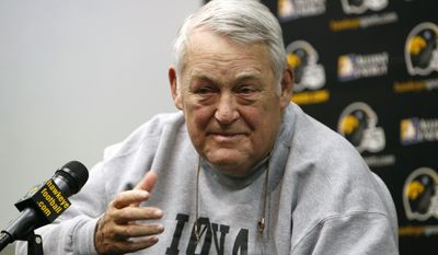 FILE - In this Dec. 16, 2011 file photo, Iowa defensive coordinator Norm Parker announces his plans to retire during a news conference in Iowa City. Former Iowa defensive coordinator Norm Parker  has died. He was 72. School spokesman Steve Roe told The Associated Press that Parker died early Monday, Jan. 13, 2014. (AP Photo/Charlie Neibergall, File)