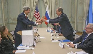 U.S. Secretary of State John Kerry, standing left, gives a pair of Idaho potatoes as a gift for Russia's Foreign Minister Sergey Lavrov at the start of their meeting at the U.S. Ambassador's residence in Paris, France, Monday, Jan. 13, 2014. Kerry is in Paris on a two-day meeting on Syria to rally international support for ending the three-year civil war in Syria. (AP Photo/Pablo Martinez Monsivais, Pool)
