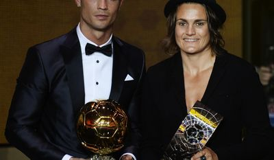 Cristiano Ronaldo of Portugal, left, and Nadine Angerer of Germany pose with their trophies after being elected FIFA Men's and Women's soccer player of the year 2013 at the FIFA Ballon d'Or 2013 gala at the Kongresshaus in Zurich, Switzerland, Monday, Jan. 13, 2014. (AP Photo/Keystone, Steffen Schmidt)
