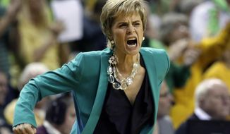 Baylor head coach Kim Mulkey motivates her team after a score late in the second half during an NCAA college basketball game against Connecticut, Monday, Jan. 13, 2014, in Waco, Texas. Connecticut won 66-55 at Baylor, ending the Lady Bears' national-best 69-game home winning streak Monday night. (AP Photo/Tony Gutierrez)