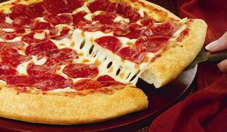 This handout photo provided by Pizza Hut,  shows a hand-tossed pizza.  Pizza Hut announced Monday, Jan. 13, 2014, it plans to start offering pizza by the slice for the first time in two test locations this week, as the chain looks to keep pace with trendy competitors offering quick, made-to-order pies. (AP Photo/Pizza Hut)