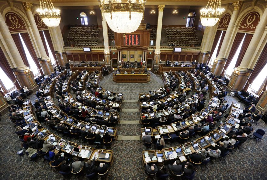 Republican House Speaker Kraig Paulsen, center, of Hiawatha, delivers his remarks during the opening day of the Iowa Legislature, Monday, Jan. 13, 2014, at the Statehouse in Des Moines, Iowa. (AP Photo/Charlie Neibergall)