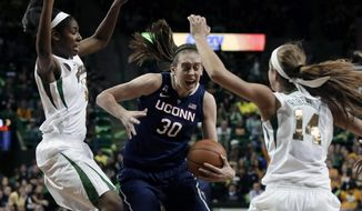 Baylor center Khadijiah Cave, left, and guard Makenzie Robertson (14) attempt to stop a drive to the basket by Connecticut's Breanna Stewart (30) in the first half of an NCAA college basketball game, Monday, Jan. 13, 2014, in Waco, Texas. (AP Photo/Tony Gutierrez)