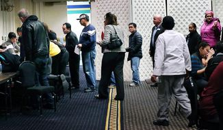 In a Monday, Jan. 6, 2014 photo, employees of the Atlantic Club Casino Hotel wait in line during an employment job fair at the property in Atlantic City, NJ. The casino will close on Jan. 13, 2014, leaving thousands of unemployed workers in its wake.  (AP Photo/The Press of Atlantic City, Michael Ein)
