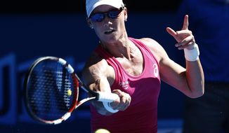 Samntha Stosur of Australia makes a forehand return to Klara Zakopalova of the Czech Republic during their first round match at the Australian Open tennis championship in Melbourne, Australia, Monday, Jan. 13, 2014.(AP Photo/Eugene Hoshiko)