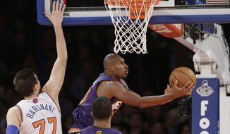 Phoenix Suns' Leandro Barbosa (10), of Brazil, drives past New York Knicks' Andrea Bargnani (77) during the first half of an NBA basketball game, Monday, Jan. 13, 2014, in New York. (AP Photo/Frank Franklin II)