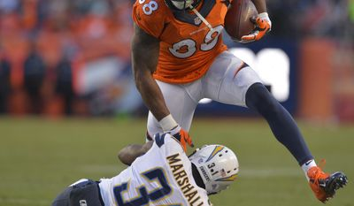 Denver Broncos wide receiver Demaryius Thomas (88) steps over San Diego Chargers cornerback Richard Marshall in the third quarter of an NFL AFC division playoff football game, Sunday, Jan. 12, 2014, in Denver. (AP Photo/Jack Dempsey)