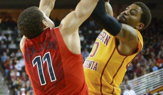 Southern California guard J.T. Terrell, right, has his shot blocked by Arizona forward Aaron Gordon during the first half of an NCAA college basketball game, Sunday, Jan. 12, 2014, in Los Angeles. (AP Photo/Mark J. Terrill)