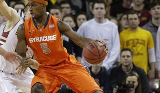 Syracuse forward C.J. Fair (5) drives toward the basket during the first half of an NCAA college basketball game against Boston College in Boston, Monday, Jan. 13, 2014. (AP Photo/Stephan Savoia)