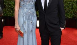 Tracy Pollan, left, and Michael J. Fox arrive at the 71st annual Golden Globe Awards at the Beverly Hilton Hotel on Sunday, Jan. 12, 2014, in Beverly Hills, Calif. (Photo by Jordan Strauss/Invision/AP)
