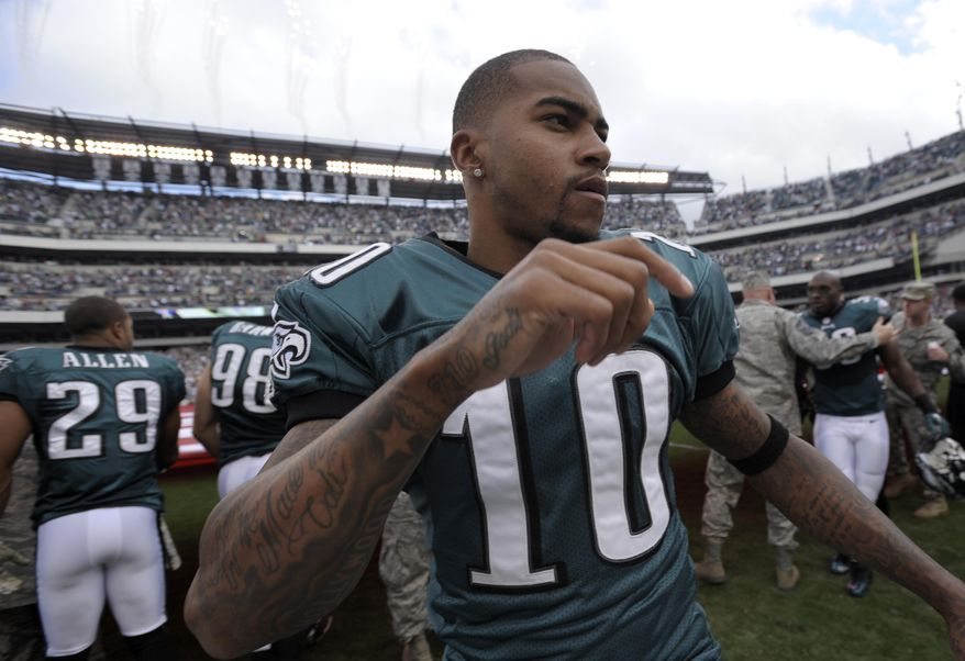 FILE - In this Nov. 17, 2013 file photo, Philadelphia Eagles' DeSean Jackson is seen during an NFL football game against Washington Redskins in Philadelphia. Philadelphia police say someone broke into a home belonging to Jackson and stole a handgun and more than $250,000 in cash and jewelry. Jackson is offering a $50,000 reward for information leading to a conviction in the burglary of his Philadelphia home. A statement from a spokeswoman for the receiver said Sunday, Jan. 12, 2014, the burglary happened while Jackson was out of town on vacation. (AP Photo/Michael Perez, File)