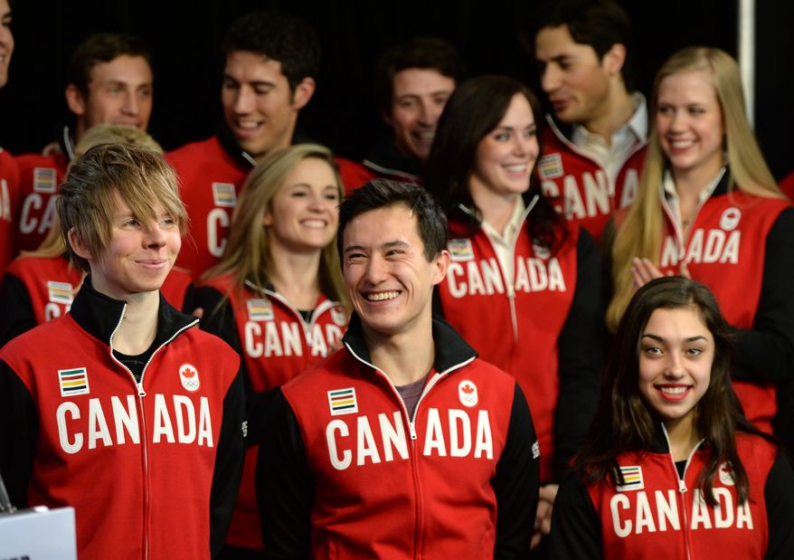 Figure skaters, bottom row from left to right, Kevin Reynolds of Coquitlam, Patrick Chan, and Gabrielle Daleman are joined by teammates during the announcement of the Canadian Olympic Team in Ottawa, Ontario, Sunday, Jan. 12, 2014. The skaters are to represent Canada in Sochi. (AP Photo/The Canadian Press, Sean Kilpatrick)