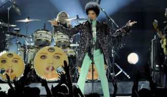 """FINE - In this May 19, 2013 file photo, Prince performs at the Billboard Music Awards at the MGM Grand Garden Arena, in Las Vegas. Fox's post-Super Bowl party will include Prince making a guest appearance on the comedy """"New Girl."""" (Photo by Chris Pizzello/Invision/AP, File)"""