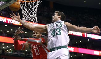 Houston Rockets power forward Dwight Howard (12) and Boston Celtics power forward Kris Humphries (43) battle for a rebound in the first half of an NBA basketball game in Boston, Monday, Jan. 13, 2014. (AP Photo/Elise Amendola)