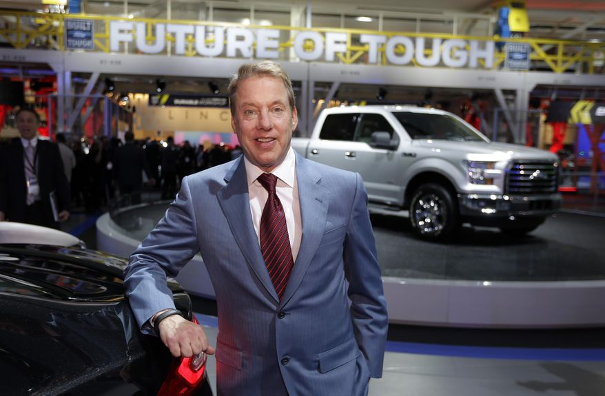 Ford Motor Co., Executive Chairman Bill Ford is photographed at the automaker's display area at the North American International Auto Show in Detroit, Monday, Jan. 13, 2014. (AP Photo/Carlos Osorio)
