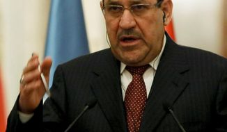 Iraqi Prime Minister Nouri al-Maliki gives a joint press conference with United Nations Secretary-General Ban Ki-Moon during Ki-moon's two day visit to Baghdad, Iraq, Jan. 13, 2014. The U.N. chief expressed deep concerns Monday over the deteriorating security situation in Iraq as an unprecedented standoff is underway between Iraqi troops and al-Qaida-linked militants in western Anbar province. Ki-moon made his comments during a joint a press conference with the Iraqi Prime Minister, Nouri al-Mailiki.  (AP Photo/Ali Al-Saadi, Pool)