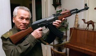 FILE - In this Wednesday, Oct. 29, 1997 file photo Mikhail Kalashnikov shows a model of his world-famous AK-47 assault rifle at home in the Ural Mountain city of Izhevsk, 1000 km (625 miles) east of Moscow.  (AP Photo/Vladimir Vyatkin, File) **FILE**