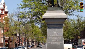 """FILE - This April 23, 2003 file photo shows a statue of a Confederate soldier at an intersection in Alexandria, Va. A city steeped in Civil War history is looking to modernize its laws by removing a provision that requires new north-south streets to be named for Confederate generals. The councilman sponsoring the law says it part of a broad effort to remove anachronistic code provisions that also outlaw lewd cohabitation and heavily regulate the bygone fad of """"rebound tumbling."""" (AP Photo/Linda Spillers, File)"""
