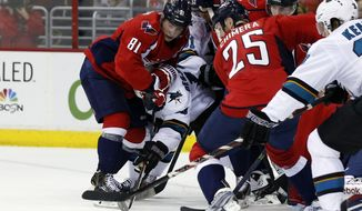 Washington Capitals defenseman Dmitry Orlov (81), from Russia, left wing Jason Chimera (25) and others combine on San Jose Sharks center Andrew Desjardins (10) in front of the goal, during the second period of an NHL hockey game, Tuesday, Jan. 14, 2014, in Washington. (AP Photo/Alex Brandon)