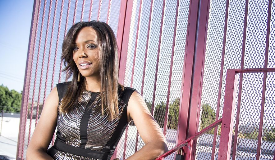 """In this Friday, Dec. 20, 2013, file photo, actress Aisha Tyler poses for a portrait in Los Angeles. Tyler is a regular panelist on the CBS' show, """"The Talk."""" She is also the voice of agent Lana Kane on FX animated series, """"Archer,"""" the fifth season of which premiered this week. (Photo by Dan Steinberg/Invision/AP)"""