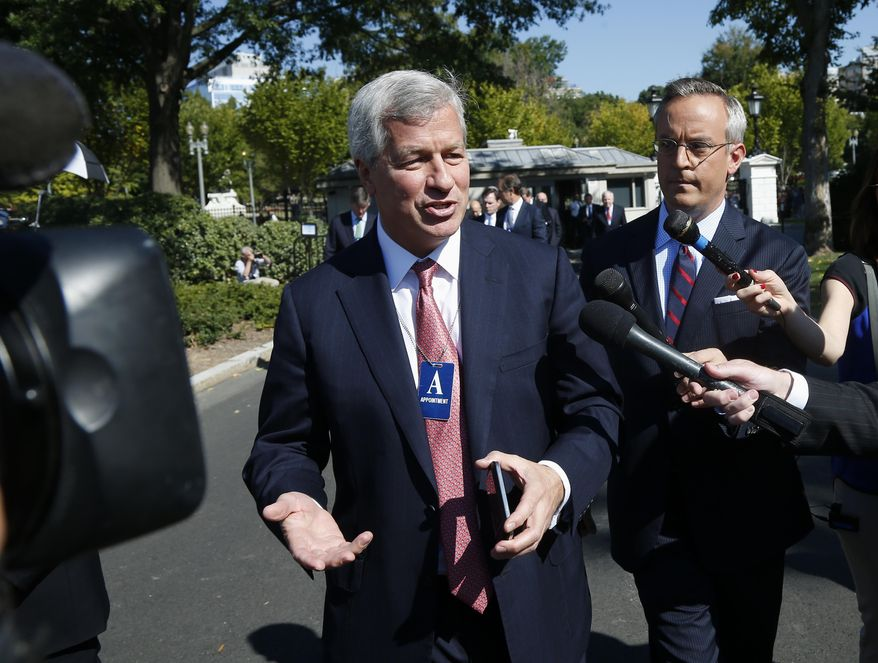FILE - In this Wednesday, Oct. 3, 2013, file photo, JPMorgan CEO Jamie Dimon is questioned by reporters as he arrives with other financial leaders for a meeting with President Barack Obama regarding the debt ceiling and the economy at the White House in Washington. More Target-sized security breaches will happen if banks and retail stores don't start working together to further protect customers' data, JPMorgan Chase's CEO Jamie Dimon said Tuesday, Jan. 14, 2014. (AP Photo/Charles Dharapak, File)