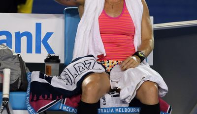 Bethanie Mattek-Sands of the U.S. sits on a chair during a break  in her first round match  against Maria Sharapova of Russia at the Australian Open tennis championship in Melbourne, Australia, Tuesday, Jan. 14, 2014.(AP Photo/Rick Rycroft)