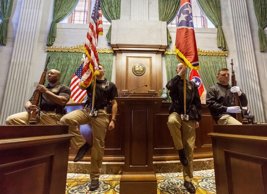 A color guard of the Tennessee Highway Patrol practices in the Senate chamber before the start of the legislative session in Nashville, Tenn., on Tuesday, Jan. 14, 2014. (AP Photo/Erik Schelzig)