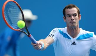 Andy Murray of Britain makes a forehand return to Go Soeda of Japan during their first round match at the Australian Open tennis championship in Melbourne, Australia, Tuesday, Jan. 14, 2014.(AP Photo/Rick Rycroft)