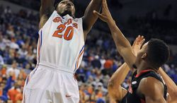 Florida guard Michael Frazier II (20) goes to the basket against Georgia during the first half of an NCAA college basketball game, Tuesday, Jan. 14, 2014, in Gainesville, Fla. (AP Photo/Phil Sandlin)