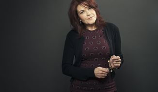 "This Dec. 17, 2013 photo shows American singer-songwriter Rosanne Cash during a portrait session to promote her new album, ""The River & The Thread"" in New York. (Photo by Victoria Will/Invision/AP)"