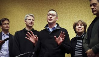 Minnesota Orchestra clarinetist Tim Zavadil  speaks about the announcement of a contract agreement with the Minnesota Orchestra as fellow musicians Kevin Watkins, Doug Wright, Marcia Peck and Tony Ross  look on Tuesday, Jan. 14, 2014, in Minneapolis, Minn. The Minnesota Orchestra and union musicians ratified a new contract Tuesday, ending a bitter, 15-month lockout that saw renowned Finnish maestro Osmo Vanska quit as conductor last fall.  (AP Photo/The Star Tribune, Renee Jones Schneider)  MANDATORY CREDIT; ST. PAUL PIONEER PRESS OUT; MAGS OUT; TWIN CITIES TV OUT  MBO TV is soft out