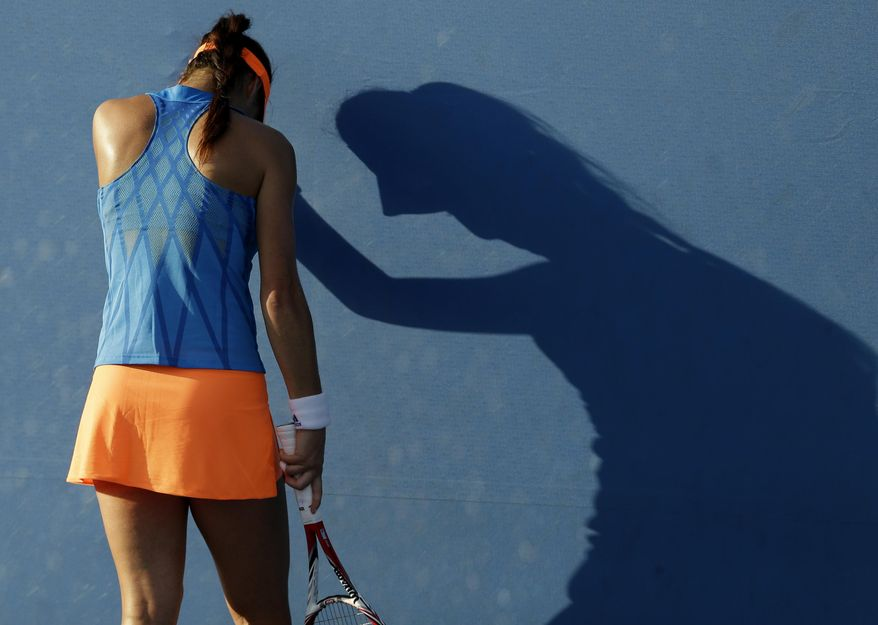 Sorana Cirstea of Romania rests on the back of the court during her first round match against Marina Erakovic of New Zealand at the Australian Open tennis championship in Melbourne, Australia, Tuesday, Jan. 14, 2014. (AP Photo/Aijaz Rahi)