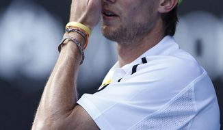 Andreas Seppi of Italy reacts after missing a point against Lleyton Hewitt of Australia  during their first round match at the Australian Open tennis championship in Melbourne, Australia, Tuesday, Jan. 14, 2014.(AP Photo/Eugene Hoshiko)