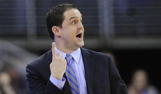 Butler coach Brandon Miller signals to his players in the first half of an NCAA college basketball game against Creighton, in Omaha, Neb., Tuesday, Jan. 14, 2014. (AP Photo/Nati Harnik)