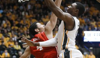 Wichita State's Cleanthony Early shoots over Bradley's Austin Barnes during the first half of an NCAA college basketball game Tuesday, Jan. 14, 2014, in Wichita, Kan. (AP Photo/Wichita Eagle, Jaime Green) LOCAL TV OUT; MAGAZINES OUT; LOCAL RADIO OUT; LOCAL INTERNET OUT