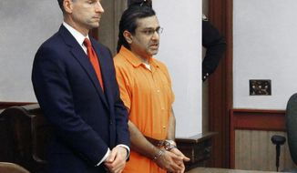 FILE-In this Friday, Dec. 20, 2013 file photo shows Ali Salim, right, apologizing for the death of Deanna Ballman with his attorney, Sam Shamansky, left, in Delaware, Ohio.   Shamansky argued Tuesday, Jan. 14, 2014 that Salim, an ex-Ohio doctor was sentenced too harshly for his convictions on charges of raping an Ballman and causing her death through a fatal heroin overdose.(AP Photo/Andrew Welsh-Huggins, File)