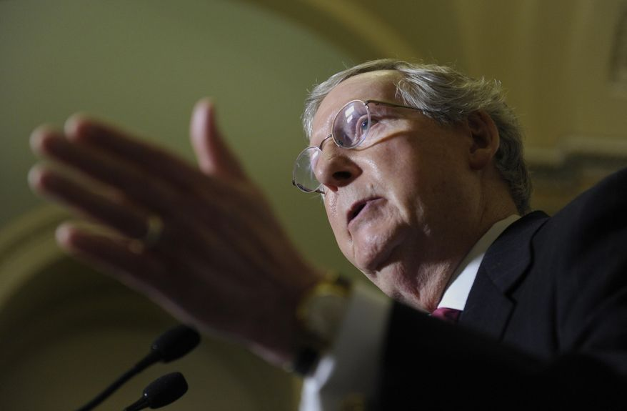 Senate Minority Leader Mitch McConnell of Ky. speaks during a news conference on Capitol Hill in Washington, Tuesday, Jan. 14, 2014, following a Republican policy lunch. A massive $1.1 trillion spending bill, aimed at funding the government through October and putting to rest the bitter budget battles of last year, is getting generally positive reviews from House Republicans who are eager to avoid another shutdown crisis with elections looming. (AP Photo/Susan Walsh)