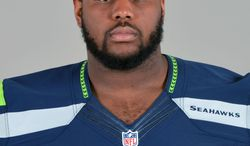 File-This is 2013 file photo shows Michael Bowie of the Seattle Seahawks. Competition is such a central theme of everything Pete Carroll does with the Seattle Seahawks that he gave a rookie seventh-round pick a chance to start at left guard in the NFC playoffs. Bowie responded to the challenge presented by his head coach. (AP Photo/File)