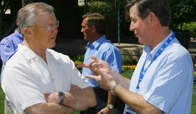 **FILE** Washington Redskins head coach Joe Gibbs, left, and San Diego Chargers head coach Norv Turner, right, talk outside during a break at the annual NFL meetings Monday, March 26, 2007, at the Arizona Biltmore resort in Phoenix. (AP Photo/Ross D. Franklin)